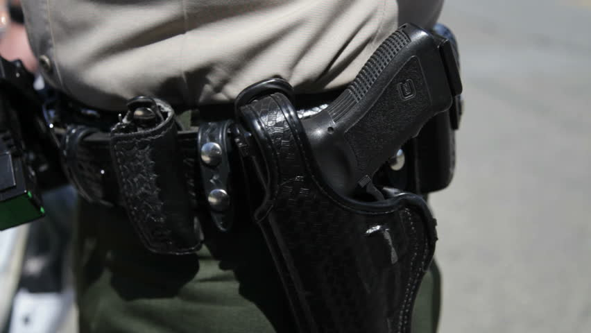 Close up of CHP gun holster - HD stock footage clip