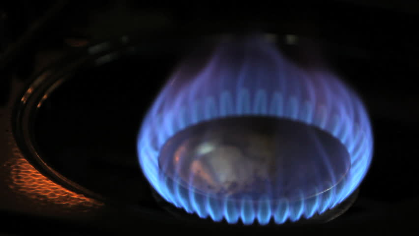 Stove top natural gas burner turning on and off - HD stock footage clip