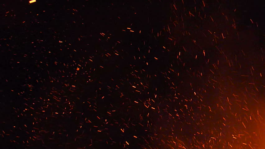 Burning ash rise from large fire in the night sky. - HD stock footage clip