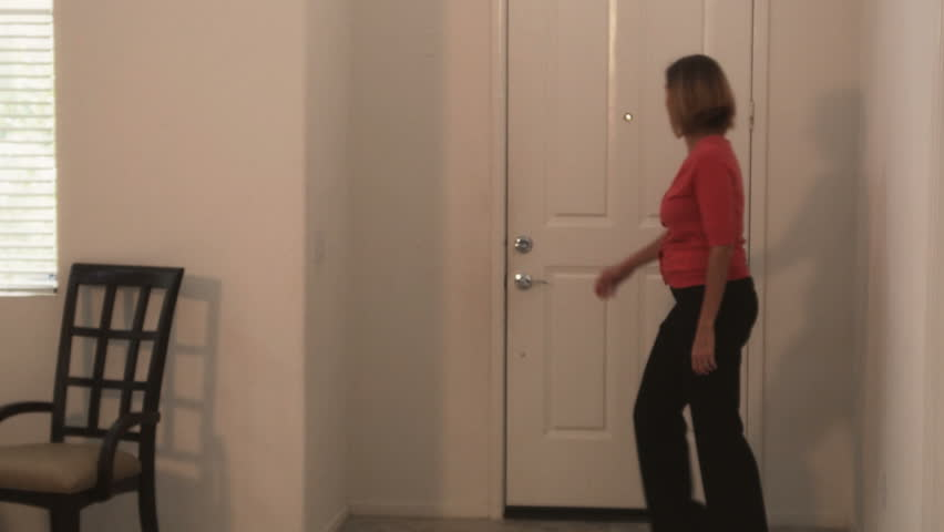 Woman realtor being let into home | Shutterstock HD Video #2333015