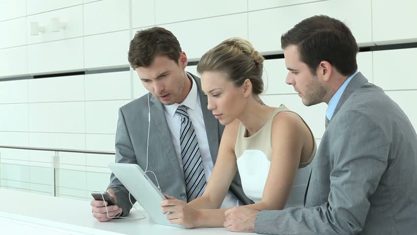 Business team working on electronic tablet - HD stock video clip