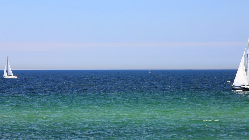 Sailboats on the baltic sea on the german coast by Kuehlungsborn - HD stock footage clip
