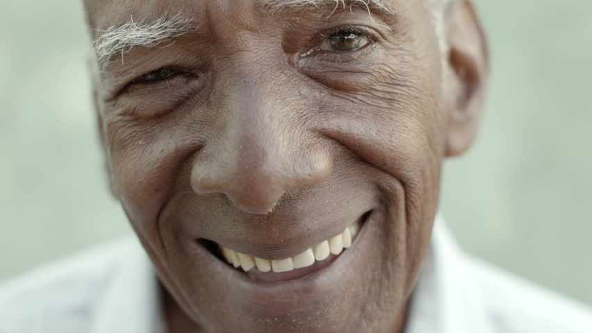 Closeup of happy old black man smiling at camera - HD stock video clip