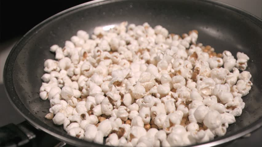 Popcorn jumping in super sow motion in a frying pan - HD stock video clip