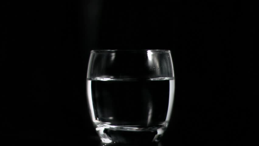 Dissolving Two Pain Killer Tablets In Glass Of Water