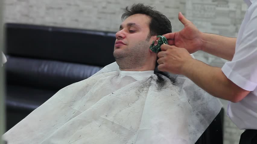 barber shop, men is waxing - HD stock video clip