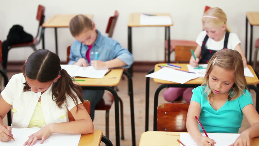 Young girls doing exercises in the classroom - HD stock footage clip