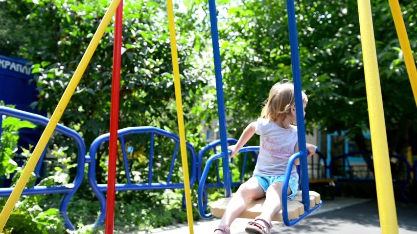 Little Girl on the Swing - HD stock footage clip