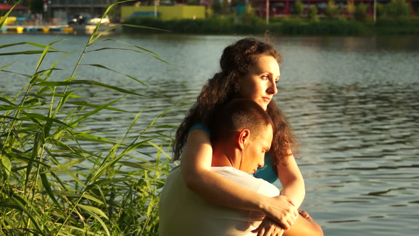 Couple in lover young adult near water - HD stock footage clip