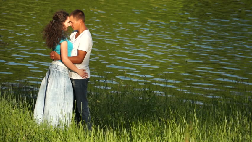 Loving couple near the water - HD stock video clip