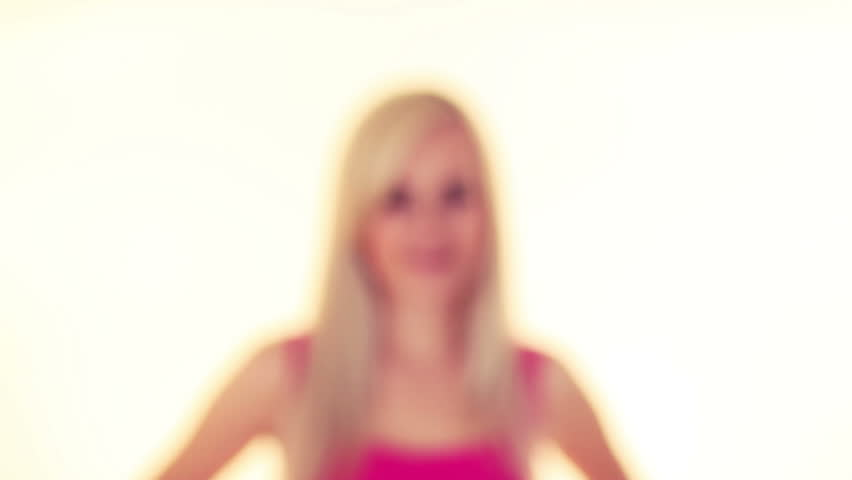 young blonde woman flirting and smiling, over white background - HD stock video clip