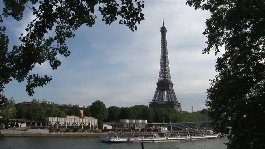 View of Debilly Footbridge and Eiffel Tower in Paris France framed in trees | Shutterstock HD Video #2402099