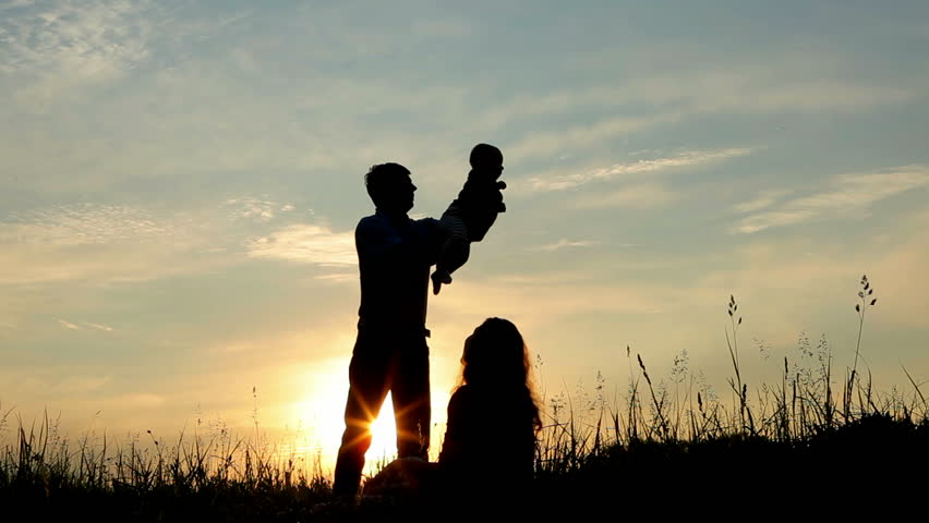 Happy family: father, mother and baby playing at sunset. Silhouettes | Shutterstock HD Video #2405141