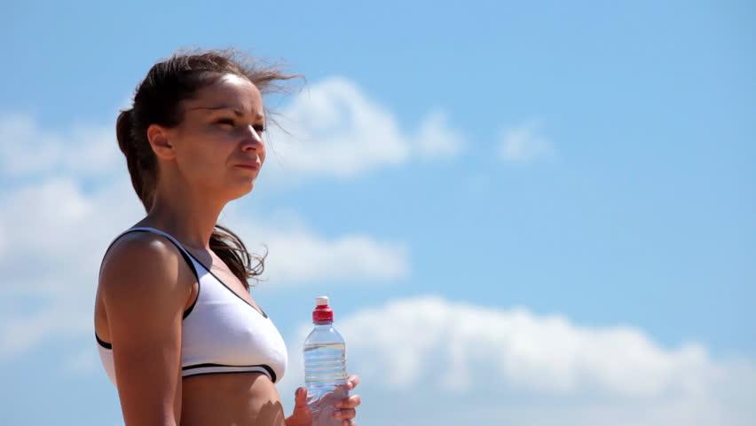 Woman drinks water - HD stock video clip
