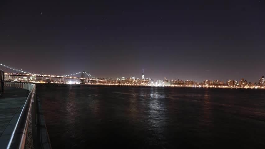 USA, New York City, Manhattan's financial district, and the Brooklyn Bridge with ships and planes passing by - night time-lapse 4k | Shutterstock HD Video #24237575