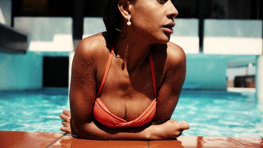 Beautiful woman having fun in a resort swimming pool, relaxing in the water and sunbathing | Shutterstock HD Video #24240869