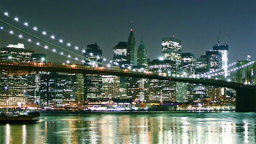 Manhattan skyline and Brooklyn bridge at night. Time lapse and loopable. High quality footage - original size 4k (4096x2304) - HD stock footage clip