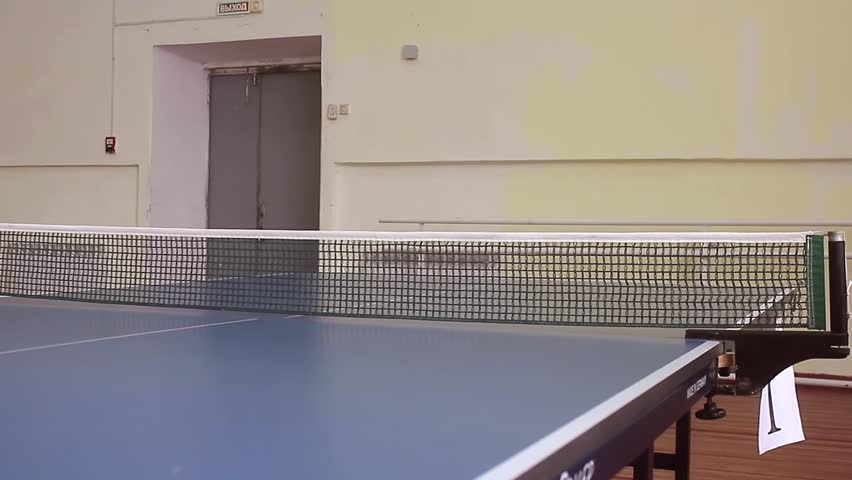 Young sports man tennis-player in play on old gym. Action shot.   Shutterstock HD Video #24251012