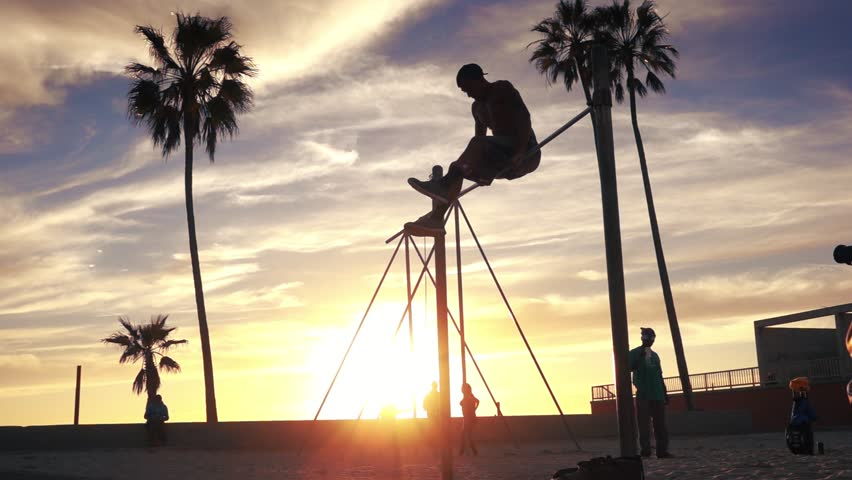 LOS ANGELES - February 2017: Silhouettes or people training at famous Muscle Beach in Venice, California. Slow motion. | Shutterstock HD Video #24251597