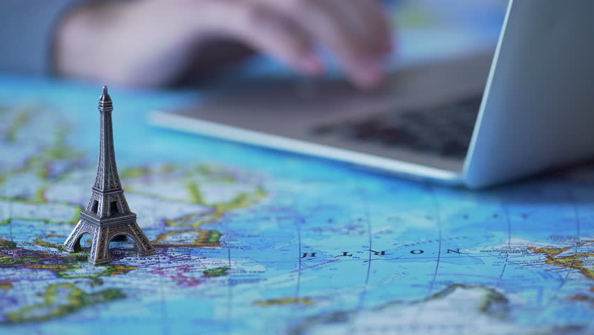 Hands of man organizing vacation in France, buying tickets online on laptop   Shutterstock HD Video #24260660