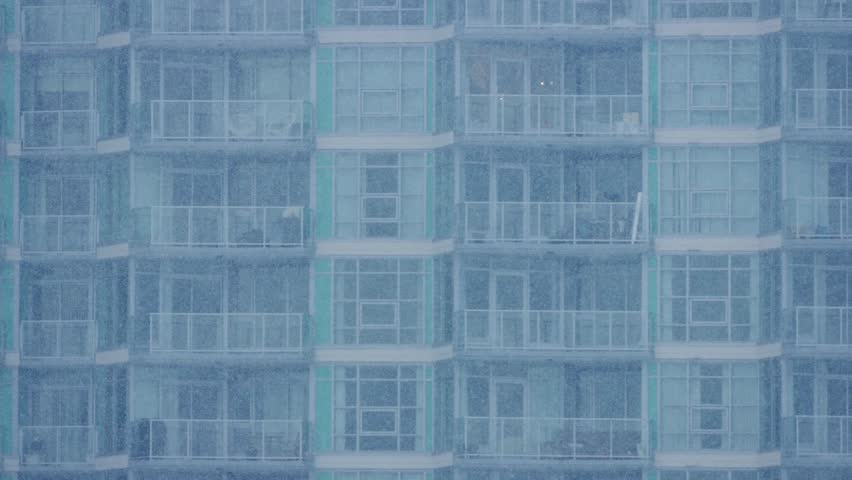 Apartment Building In Heavy Snowfall | Shutterstock HD Video #24262694