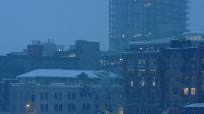 City Buildings In Snowfall In The Evening | Shutterstock HD Video #24262811