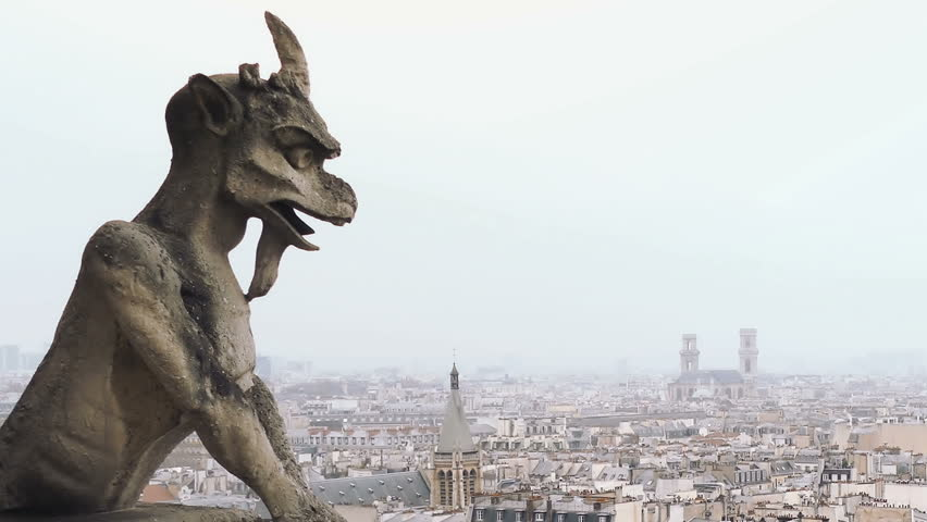 Notre Dame Cathedral gargoyle overlooking city of Paris, France background    Shutterstock HD Video #24264449
