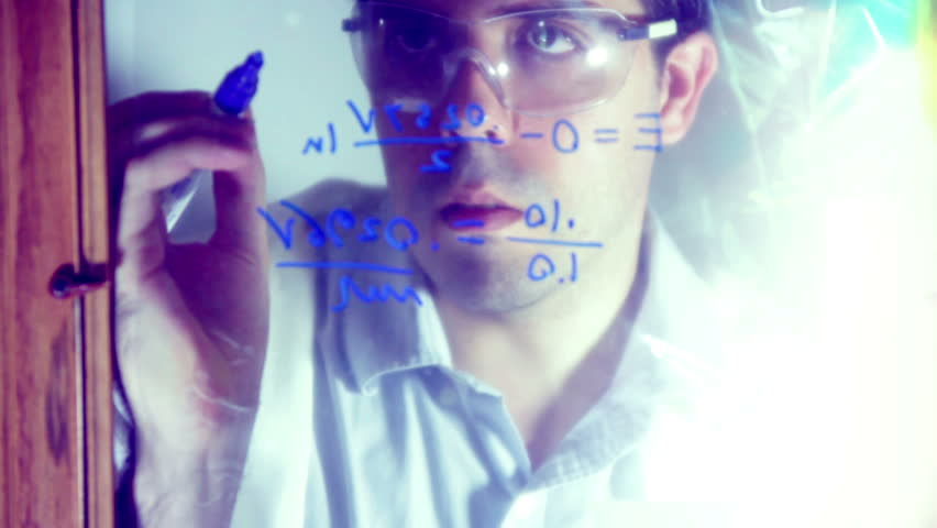 Chemist writing down some chemical equations. - HD stock footage clip