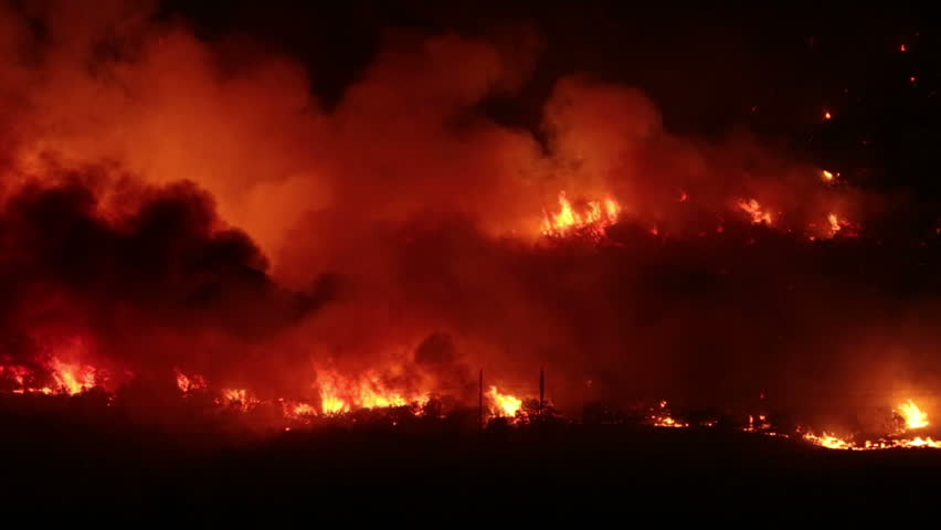 FOUNTAIN GREEN, UTAH - JUN 23: The Sanpete forest fire burns out of control during the night in Wood Hollow Canyon on June 23, 2012 in Fountain Green, Utah. The fire had burned over 6,000 acres and caused more than 500 homes to be evacuated as of June 25. - HD stock video clip