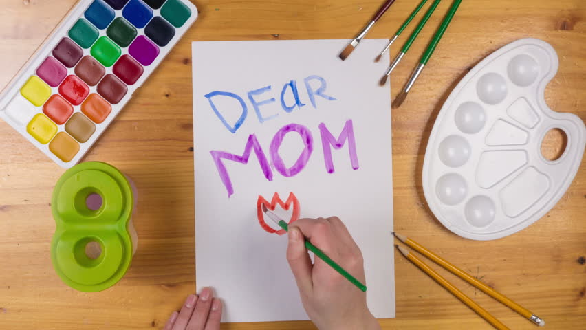 Kid draw greeting card on white paper for mothers day, stop motion animation, top view | Shutterstock HD Video #24367292