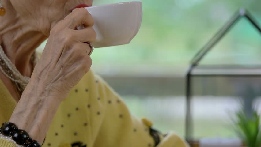 Senior woman with cup talking. Lady drinking coffee. Advice from an expert. | Shutterstock HD Video #24384635