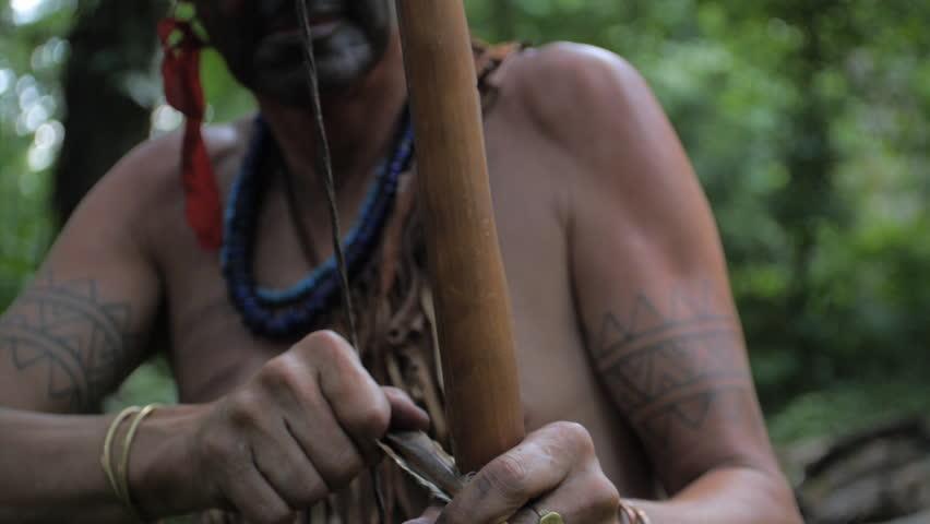 VIRGINIA - SUMMER 2015 - Reenactment, Recreation. Ancient -18th & 19th century, 1500s-1800s Native American, Eastern Woodland Indian Warrior, Powhatan hunting, warpath with bow & arrow.  Flint arrow. | Shutterstock HD Video #24403454