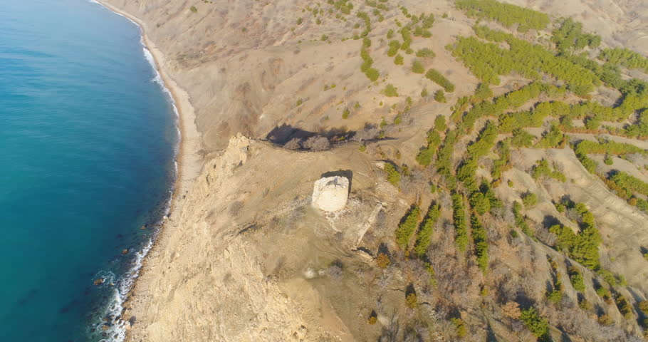 Flying around old ruined tower on a cliff near sea coastline. Aerial view. | Shutterstock HD Video #24426926