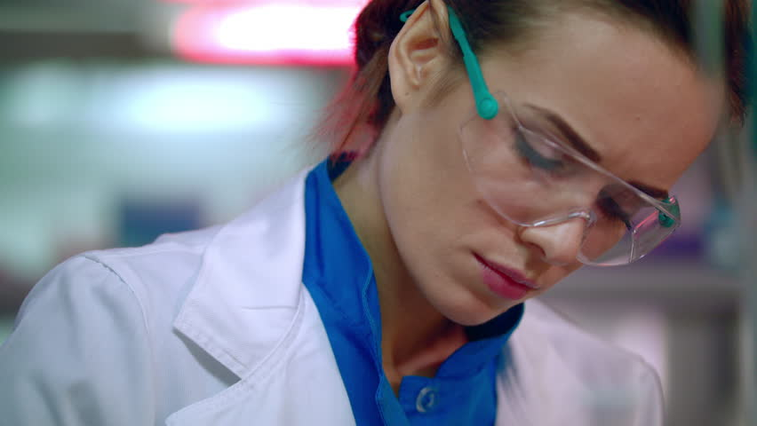 Woman scientist portrait. Female scientist face close up. Serious scientist woman working. Medical scientist thinking. Lab woman face in safety glasses. Female lab technician working | Shutterstock HD Video #24435224