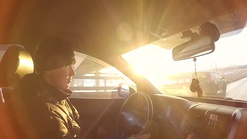 The guy drives the car on a Sunny day   Shutterstock HD Video #24477515