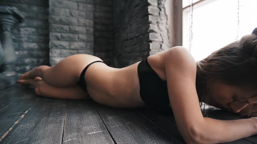 Sexy young woman in underwear with beautiful long hair posing on the wooden floor. Studio shot | Shutterstock HD Video #24496100