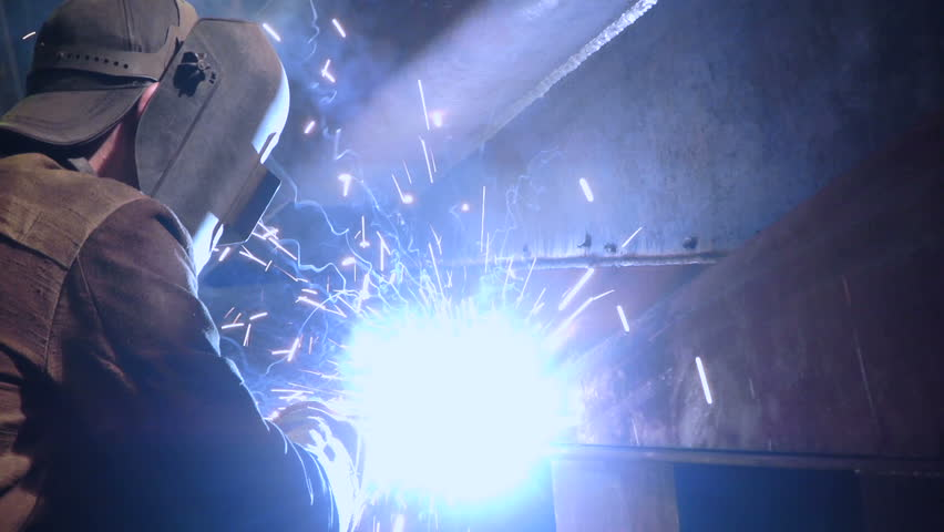 worker in welding facility   - HD stock footage clip