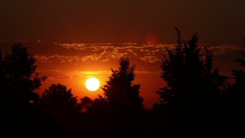 The brilliant sun, with red sky caused by a massive forest fire. HD 1080p time