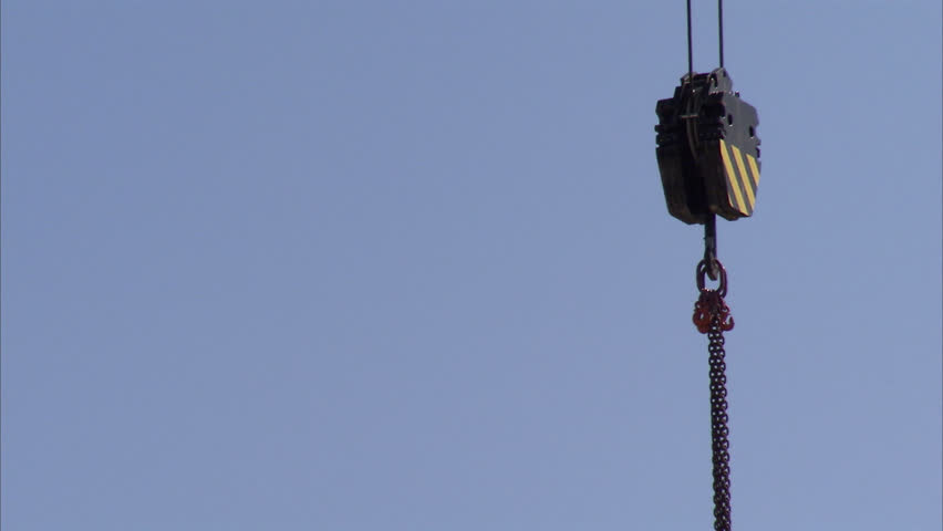 Lifting crane against the sky - HD stock footage clip
