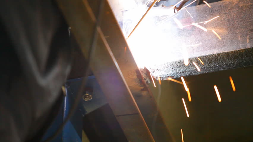 Welder is working with metal construction. Close-up of manual hand arc welding machine. | Shutterstock HD Video #2468051
