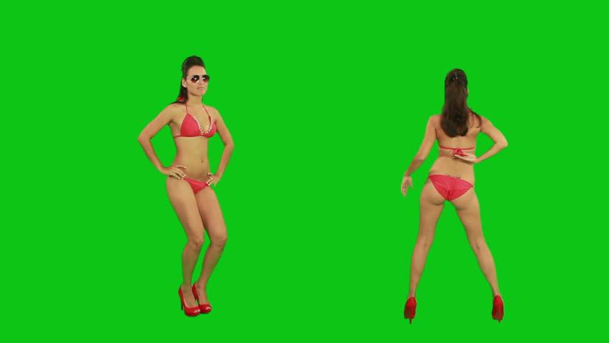 Beautiful young girl dancing against green screen    Shutterstock HD Video #2469725
