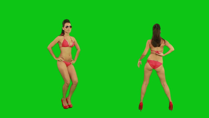 Beautiful young girl dancing against green screen  - HD stock video clip