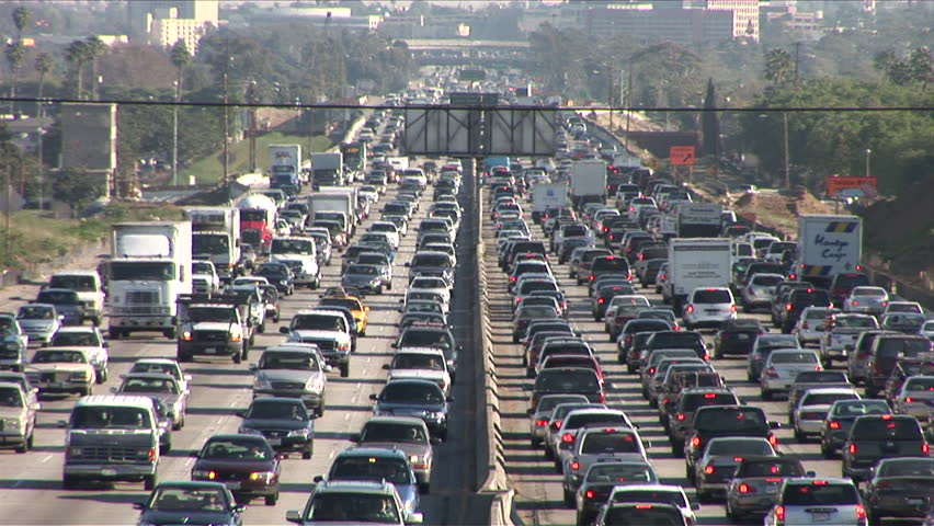 Los Angeles, CA - CIRCA February 2006: Sitting in the hot California sun on the traffic riddled freeway, blasting the air conditioner and grooving to the radio, is the official state past time. | Shutterstock HD Video #2475530
