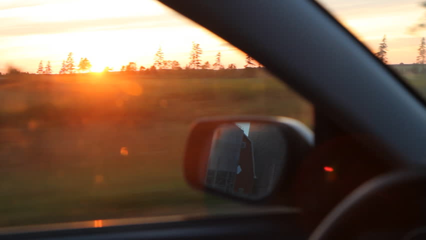 Sunset drive. Driving in the country, with sun going down. Prince Edward Island, Canada.