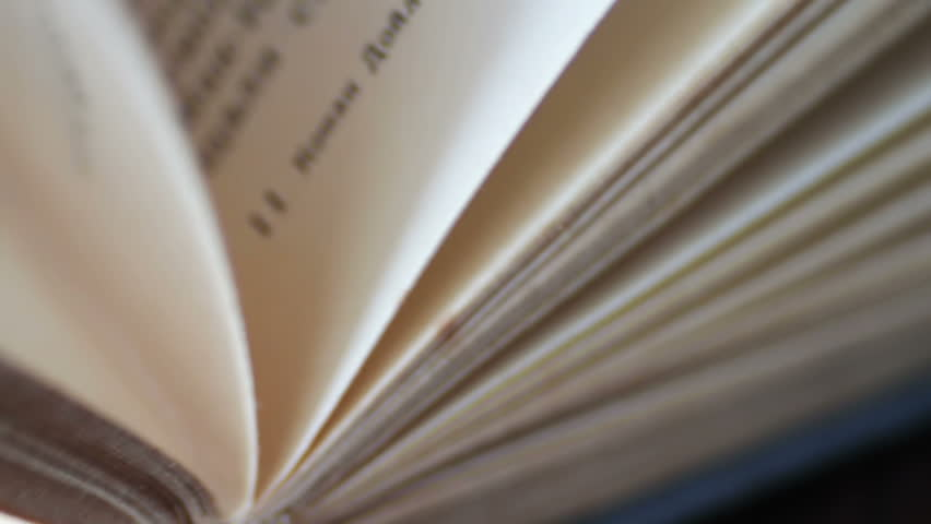 Scrolling a Book in Macro.Turning the pages of an old book close-up.Book pages turning | Shutterstock HD Video #24768584