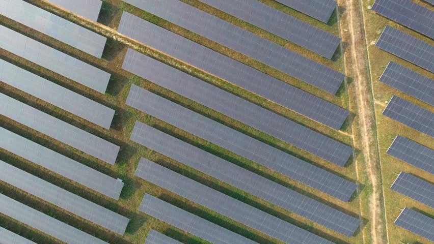 Aerial view large industrial Solar Energy Farm producing concentrated solar energy. Solar Energy Farm at Thailand  | Shutterstock HD Video #24784676