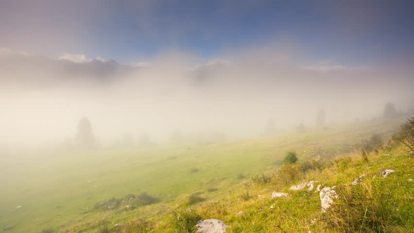 Fantastic misty view on the Bohinj valley in sunlight. Picturesque and lovely scene. Location place Triglav national park, Julian Alps. Slovenia, Europe. Beauty world. Time lapse clip, interval video. | Shutterstock HD Video #24811946