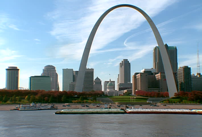 ST LOUIS - Circa 2002: Gateway Arch in the Skyline of St. Louis with boats in the Mississippi River in 2002.