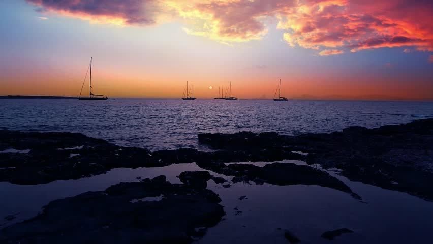 Ibiza sea sunset view from Formentera Balearic islands with Es Vedra in horizon and dramaric red sky - HD stock video clip