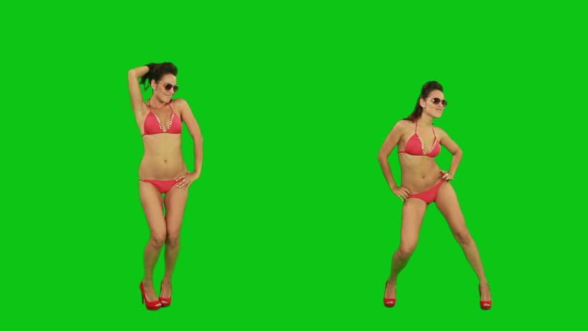 Beautiful young girl in bikini dancing against green screen | Shutterstock HD Video #2498363